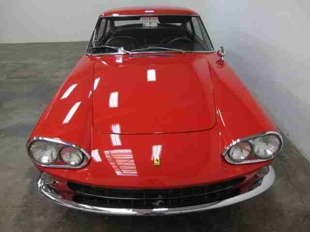 Red '66 Ferrari 330 GT matching